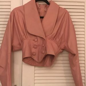 Pink leather crop jacket.
